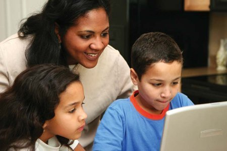 Mom with kids at computer